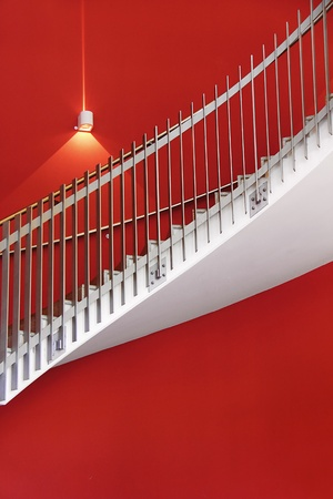 modern interior architecture: white stair with red wall and one light