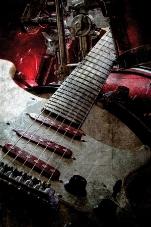 Old retro look of a electric guitar and drums