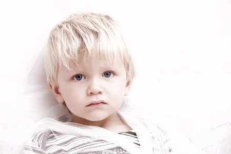 blond boy: little sweet baby boy is looking into the camera - high key