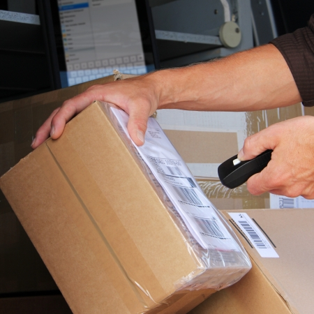 delivery package: Parcel delivery with  parcel label barcode scanning