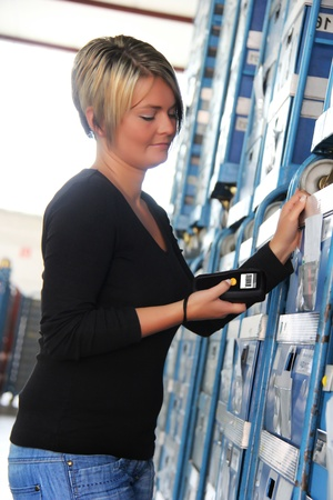 the reader: worker scans pallets and boxes in the warehouse Stock Photo