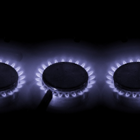 gas fire: three hot burning gas cookers with blue power