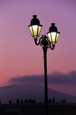 old retro streetlight in front of a mediterranean sunset photo