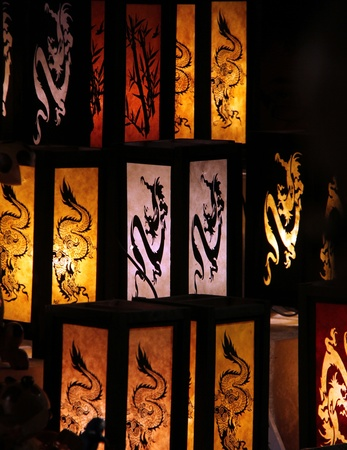 lighten: many colorfully china lanterns are lighten bright in the darkness