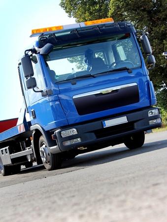 Nouveau véhicule de dépannage bleu avec feux de signalisation jaunes Banque d'images - 10694052