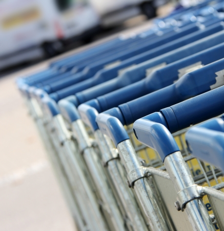 shopping trolleys: many shopping carts in a row are waiting for using