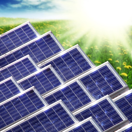photovoltaic power station: New blue solar panels in the  nature Stock Photo