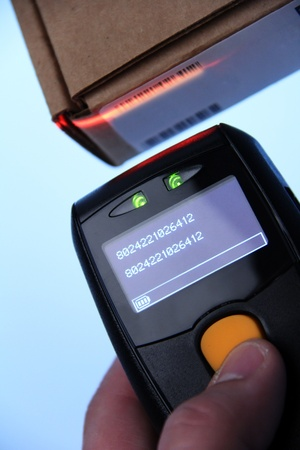 barcode scanner: hand is holding a handheld barcode scanner Stock Photo