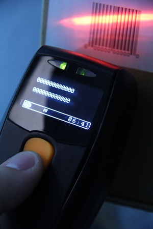 hand is holding a handheld barcode scanner Stock Photo