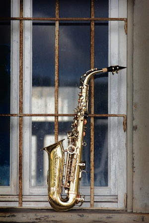 brass band: old grungy saxophone with old retro background
