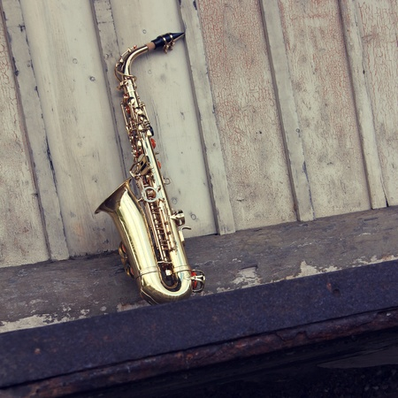 sax: old grungy saxophone with old retro background