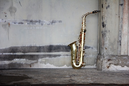 old grungy saxophone with old retro background photo