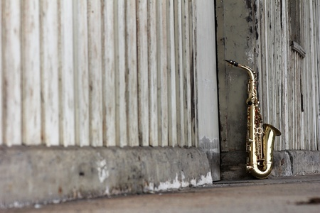 soul music: old grungy saxophone with old retro background