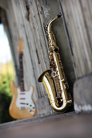 saxophone: old grungy saxophone with old retro background