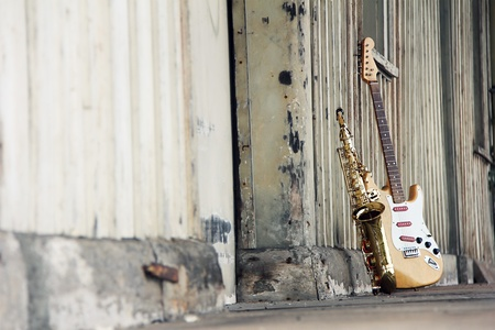 old grungy saxophone with old retro guitar photo