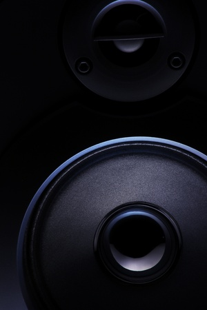 surround system: close up of a dark loudspeaker with light effect Stock Photo