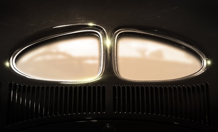 devided window on the rear of an classic car photo