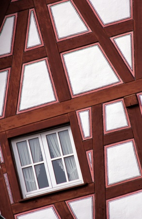 detail of a wooden half-timbered framework house construction photo