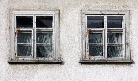 detail of an old house with wooden windows photo