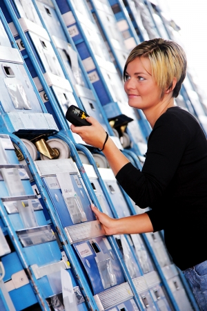 scan: worker scans pallets and boxes in the warehouse Stock Photo