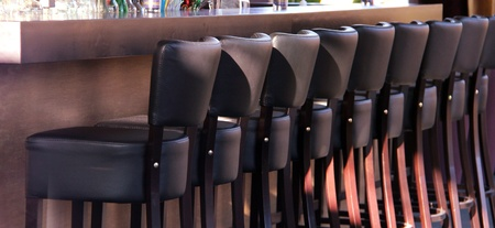 Many bar seats with leather in a row