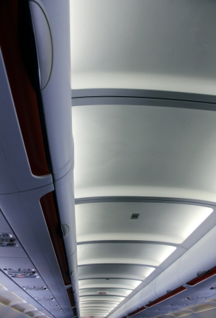 compartments: the modern ceiling in the aeroplane with lights