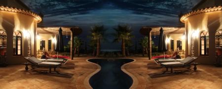 Au sud de la mer de façade avec de jolies lumières, des palmiers et une piscine Banque d'images - 15236879