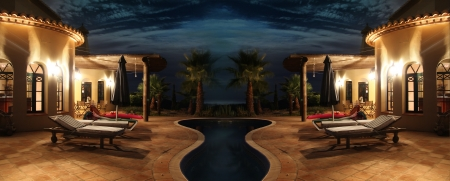 evening class: south sea facade with nice lights, palms and pool Stock Photo