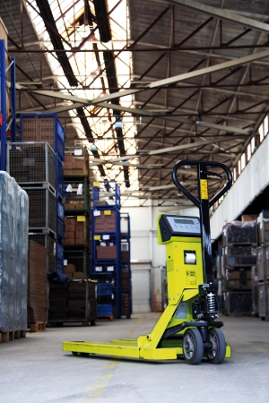 yellow pallet jack in the industrial warehouse photo