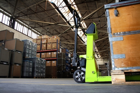 yellow pallet jack in the industrial warehouse