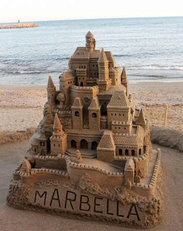 children sandcastle: large sandcastle on the beach in spain