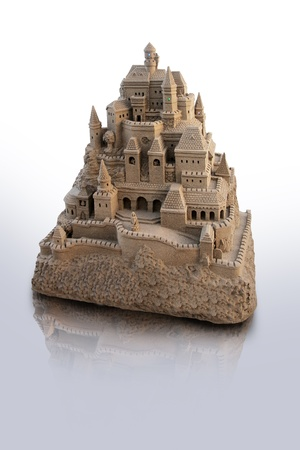 large isolated sandcastle with many towers and crenels photo