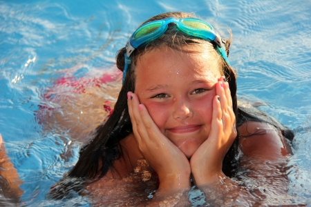 Little girl is smiling in the swimming pool Stock Photo - 15264767