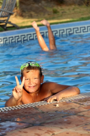 Tropical Scene with swimming pool and kids Stock Photo - 15264765