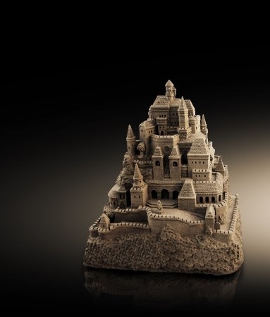 large sandcastle with many towers and crenels in retro look photo