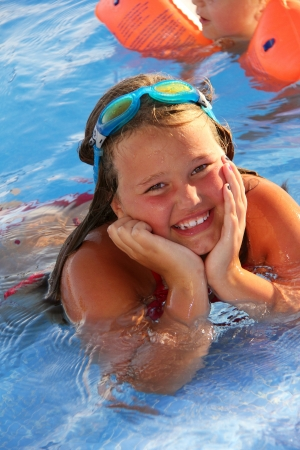 Little girl is smiling in the swimming pool Stock Photo - 15526136