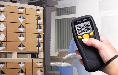 Handheld Computer for barcode scanning identification Stock Photo - 15603910