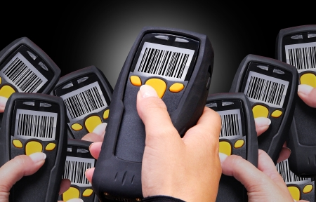 Handheld Computer for wireless barcode scanning identification Stock Photo