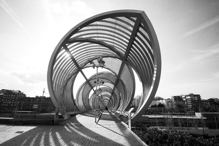 b and w: outside view of a modern architecture design bridge in Madrid in B W