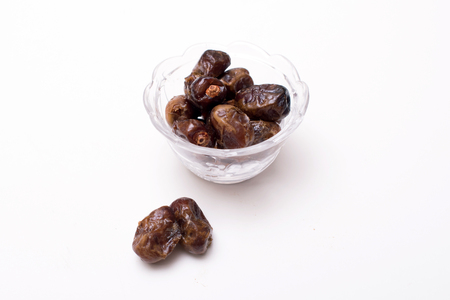ramadhan: Dried date palm fruits or kurma for ramadhan. dried date kurma fruits in a glass bowl ready to eat