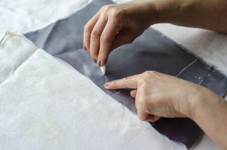 Tailor Sews a Dress 2 Archivio Fotografico