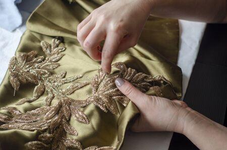 Tailor Sews a Dress