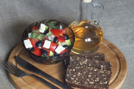 dietetic: Salad vegetables, dietetic food is nice. On natural materials. Delicious food is brilliant. Stock Photo