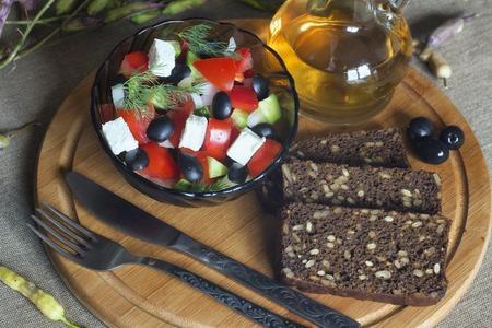 natural materials: Salad vegetables, dietetic food is nice. On natural materials. Delicious food is brilliant. Stock Photo