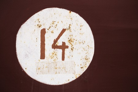 number 14: Metal surface with written number 14
