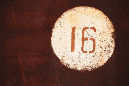 number 16: Metal surface with written number 16