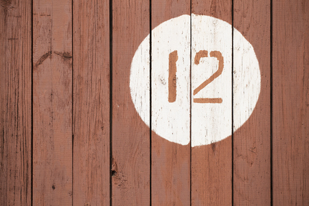 number 12: Number 12 on a wooden surface