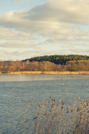 gradually: The lake is gradually released from the ice. Spring mood.