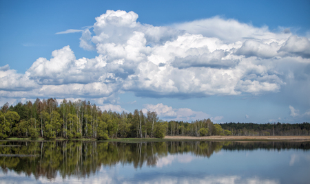 Landscape of sky with clouds pond Beautiful white billowing  against a blue . Stock Photo