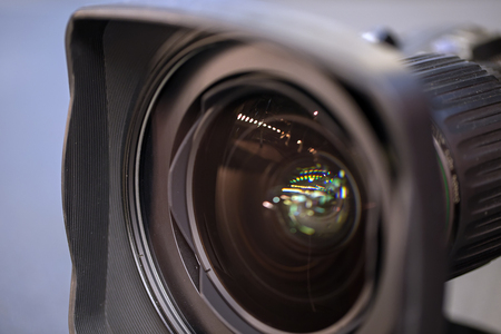 high definition television: The lens  hood with the camcorder. Clean Optics bigand small glares in the reflection Stock Photo